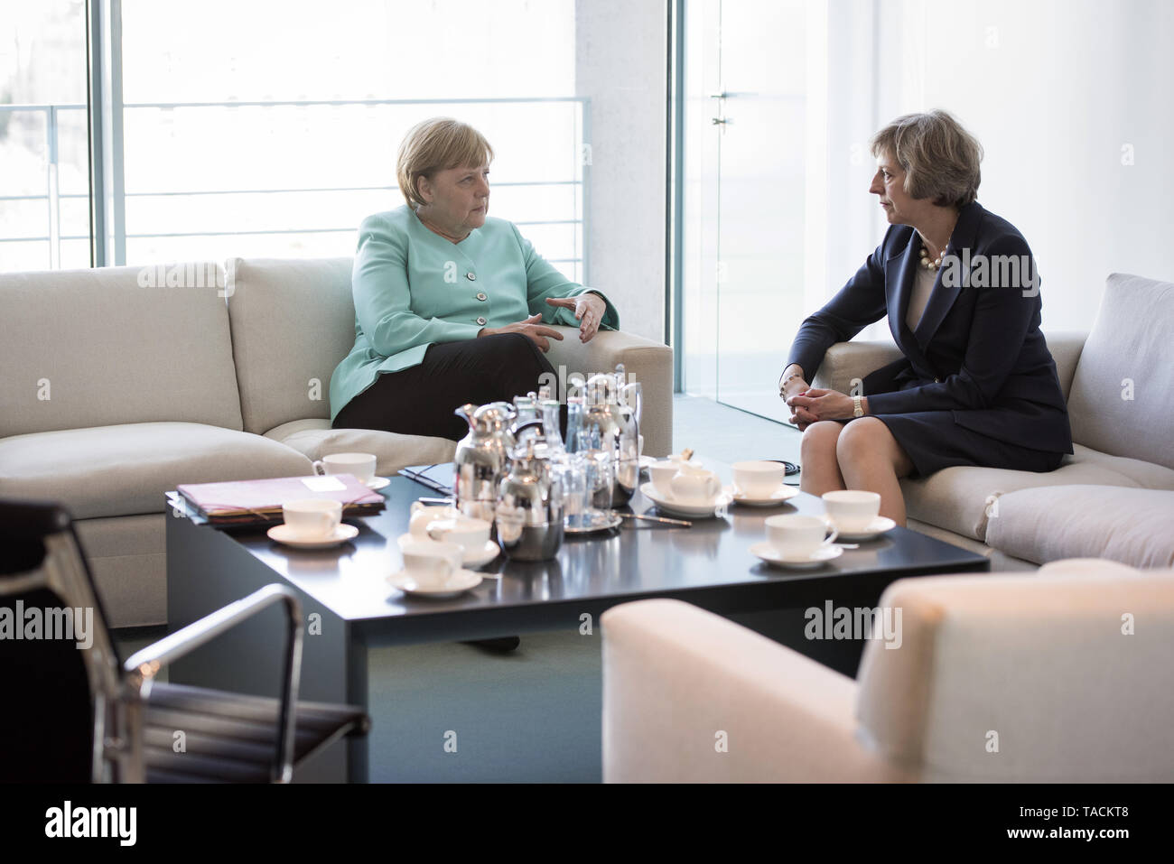 Berlin, Germany. 20th July, 2016. HANDOUT - A handout picture made available by the German Federal Government (Bundesregierung) shows German Chancellor Angela Merkel (L) and new British Prime Minister Theresa May at the beginning of their meeting held in the Federal Chancellery in Berlin, Germany, 20 July 2016. Credit: Guido Bergmann/Bundesregierung/dpa (ATTENTION EDITORS: EDITORIAL USE ONLY IN CONNECTION WITH CURRENT REPORTING/MANDATORY CREDITS: 'Guido Bergmann/Bundesregierung/dpa') | usage worldwide/dpa/Alamy Live News - Stock Image