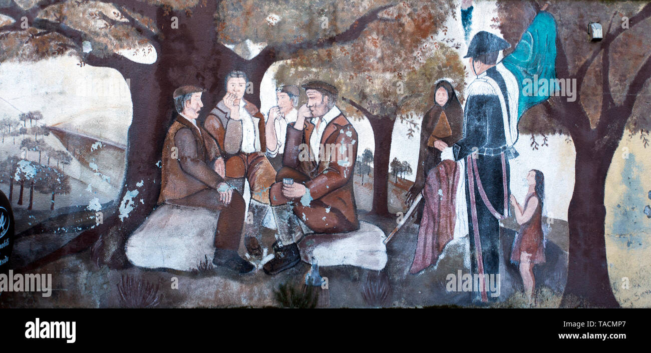 Orgosolo, Italy - December 29, 2018: Murals wall paintings about political and historical facts in Orgosolo, Sardinia, Italy - Stock Image