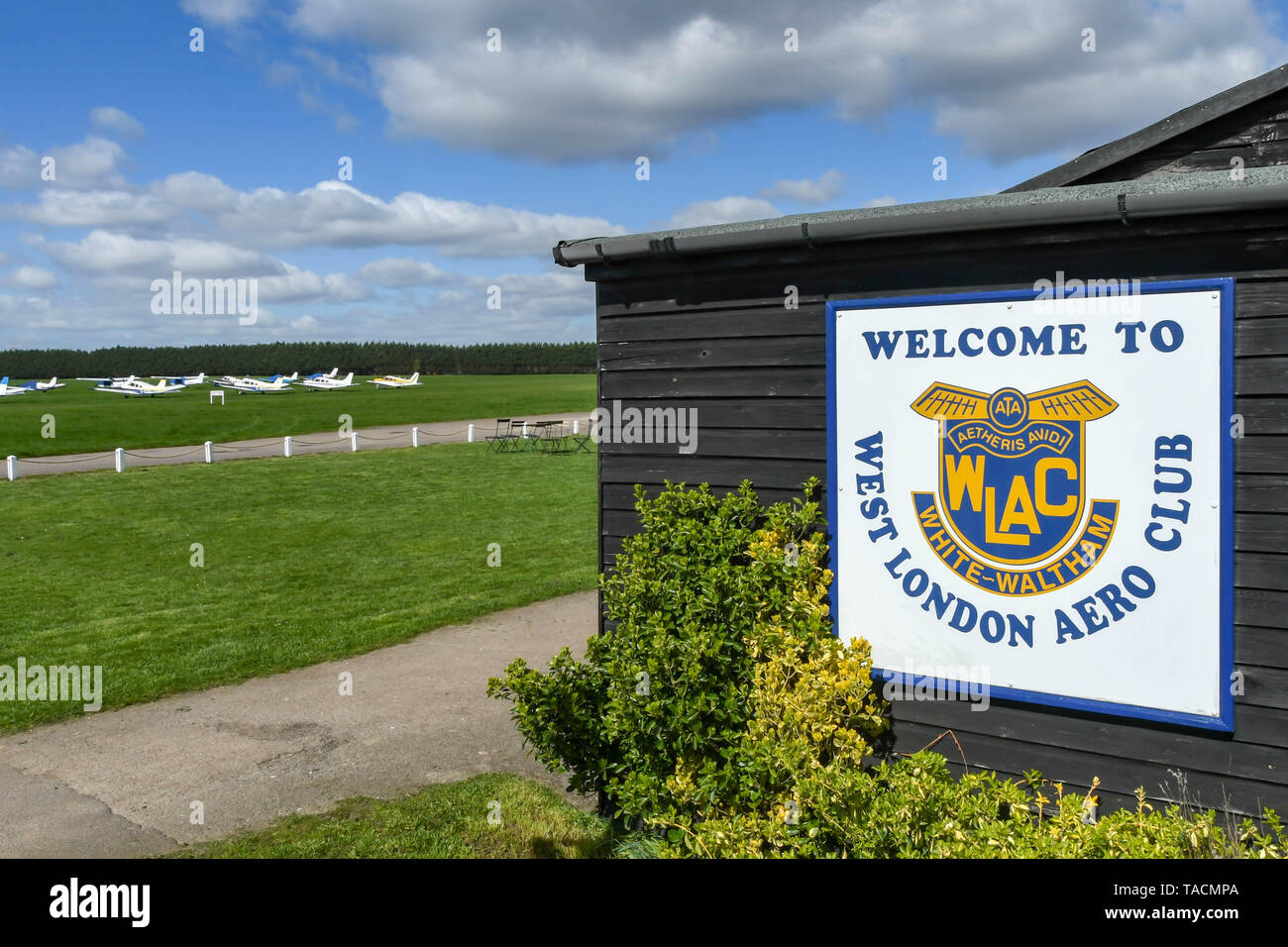 WHITE WALTHAM, ENGLAND - MARCH 2019: West London Aero Club sign on the side of a building at White Walhtam airfield. - Stock Image