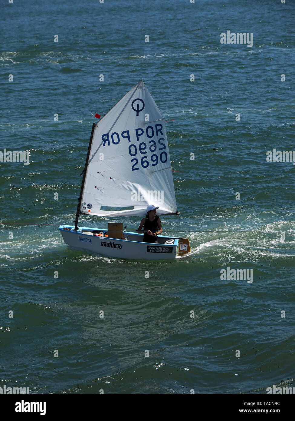 Sail boats of a sailing school on Tejo river in Lisbon - Stock Image