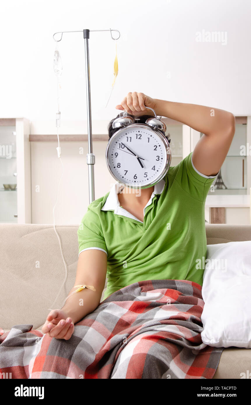 Young man suffering at home - Stock Image