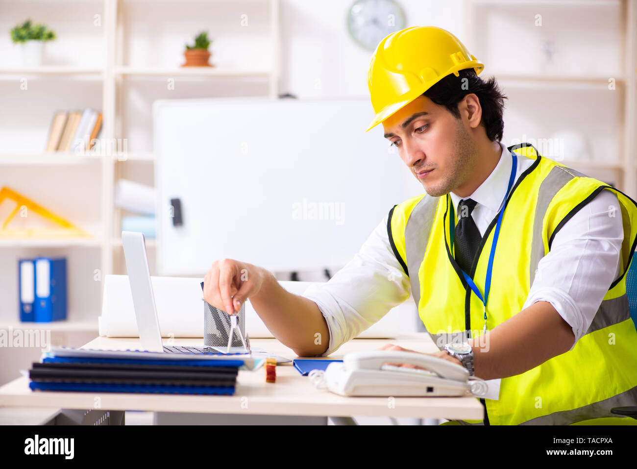 Male construction engineer working in the office - Stock Image