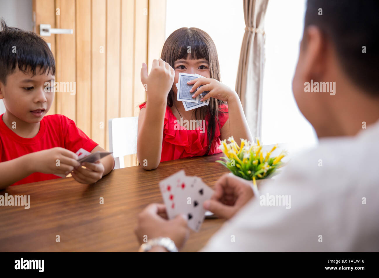 kids play card game together Stock Photo