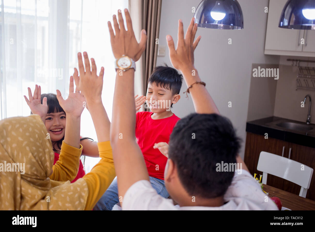 portrait of asian family enjoy their time together - Stock Image