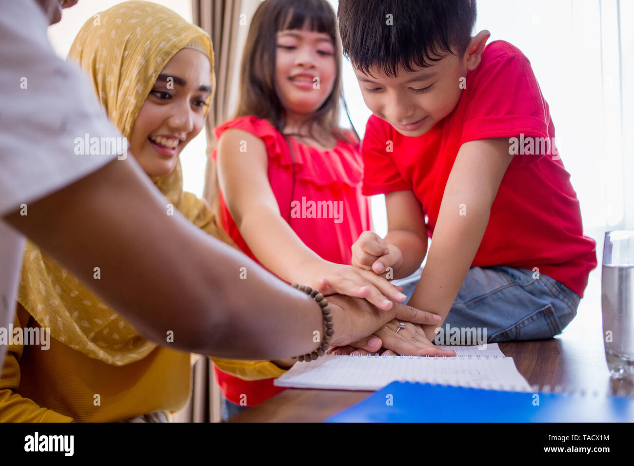 excited asian family at home play around together - Stock Image