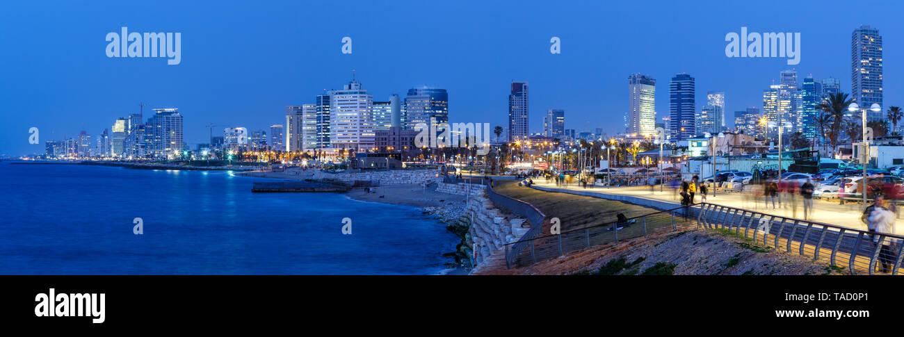 Tel Aviv skyline panorama Israel blue hour night city sea skyscrapers evening - Stock Image