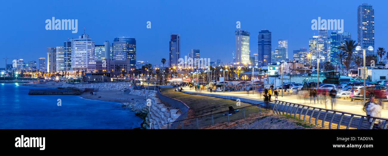 Tel Aviv skyline panorama Israel blue hour night city skyscrapers evening - Stock Image