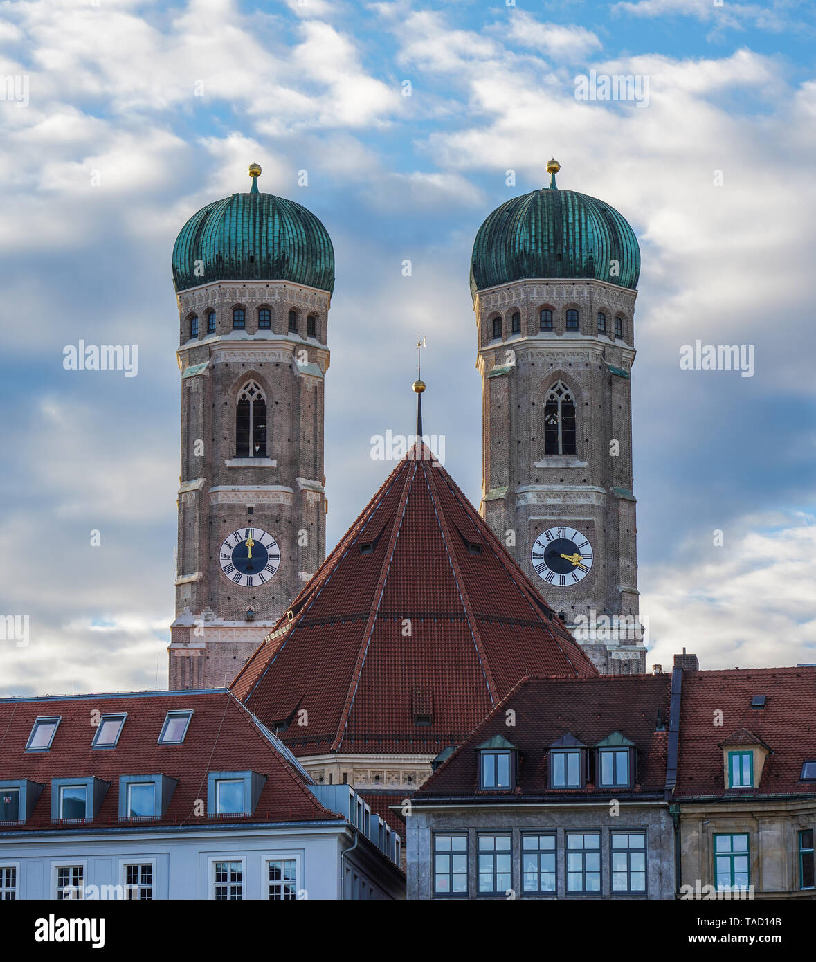 Picturesque cityscape view with the famous Munich Cathedral, also called Cathedral of Our Dear Lady - Frauenkirche, a church and landmark of Munich th - Stock Image