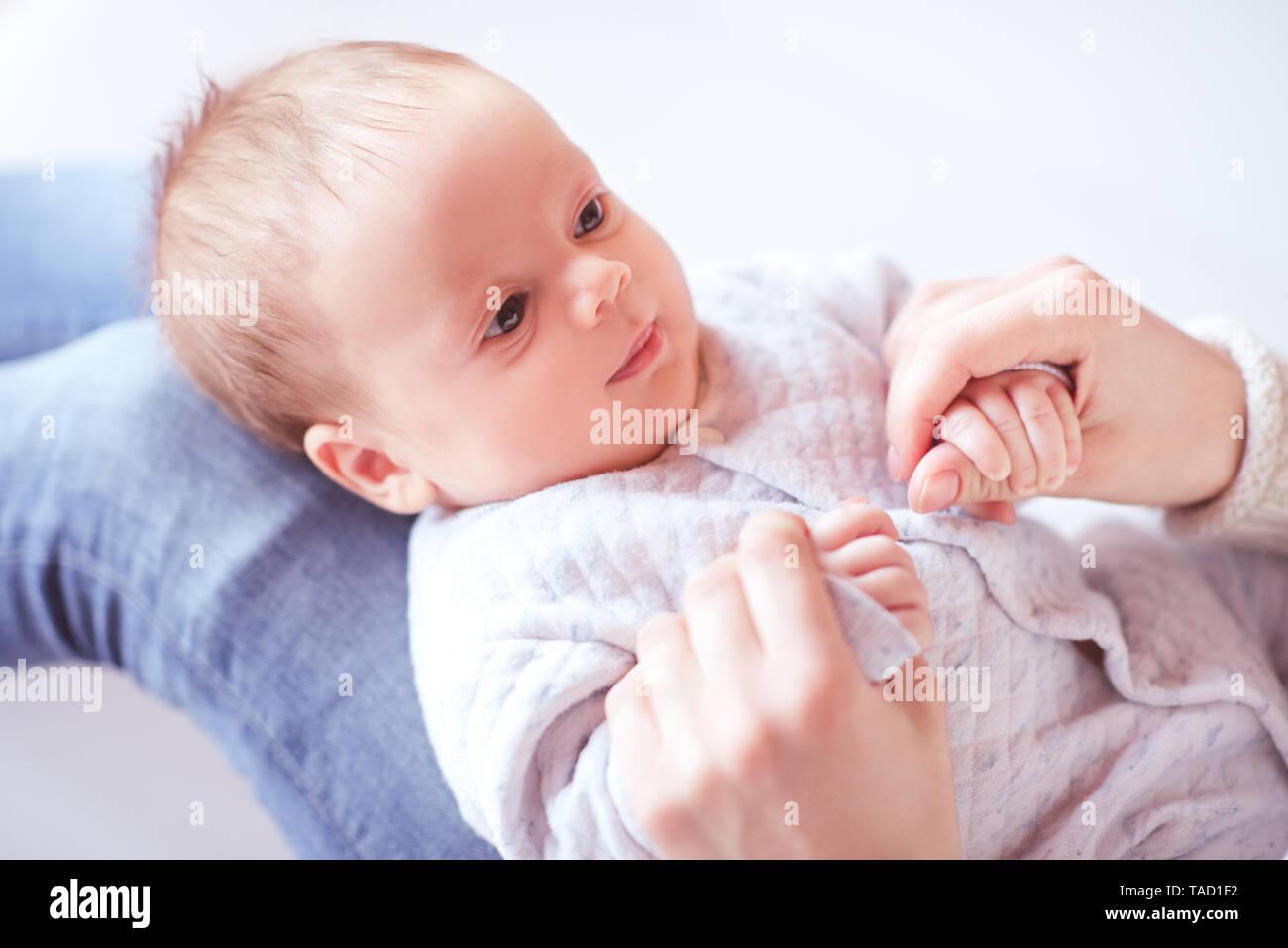 Baby boy on mother hands in room. Motherhood. Maternity. Stock Photo