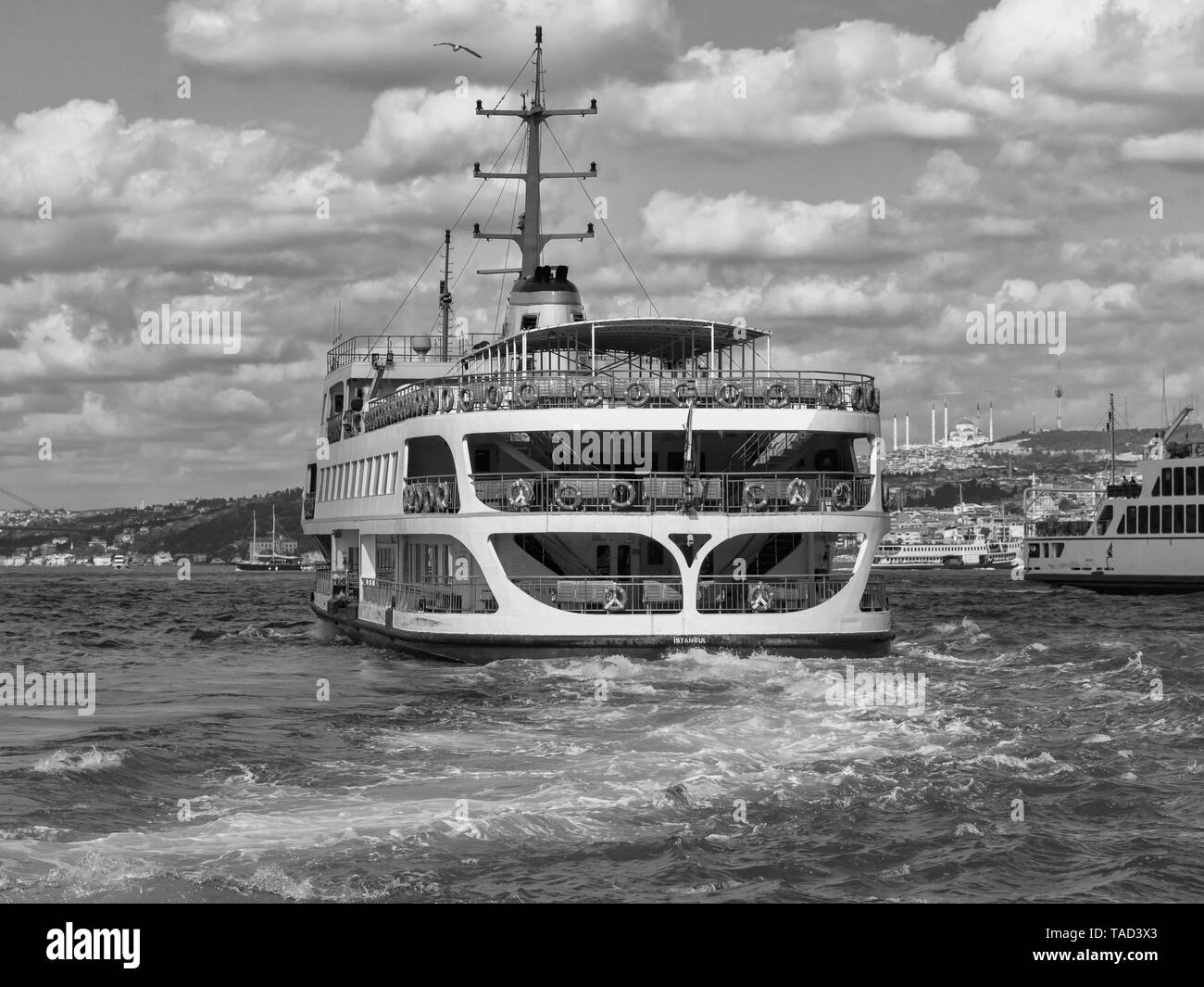Ferry boat going bosphorus tour in istanbul city when cloudy blue sky hot summer day - Stock Image