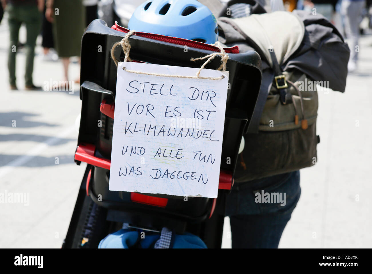 Frankfurt, Germany. 24th May 2019. A protester carries a sign that reads 'Imagine climate change is real and everyone is doing something about it'. Around 4,500 young people marched through Frankfurt to the European Central Bank, to protest against the climate change and for the introduction of measurements against it. The protest took place as part of an Europe wide climate strike, two days ahead of the 2019 European elections. - Stock Image