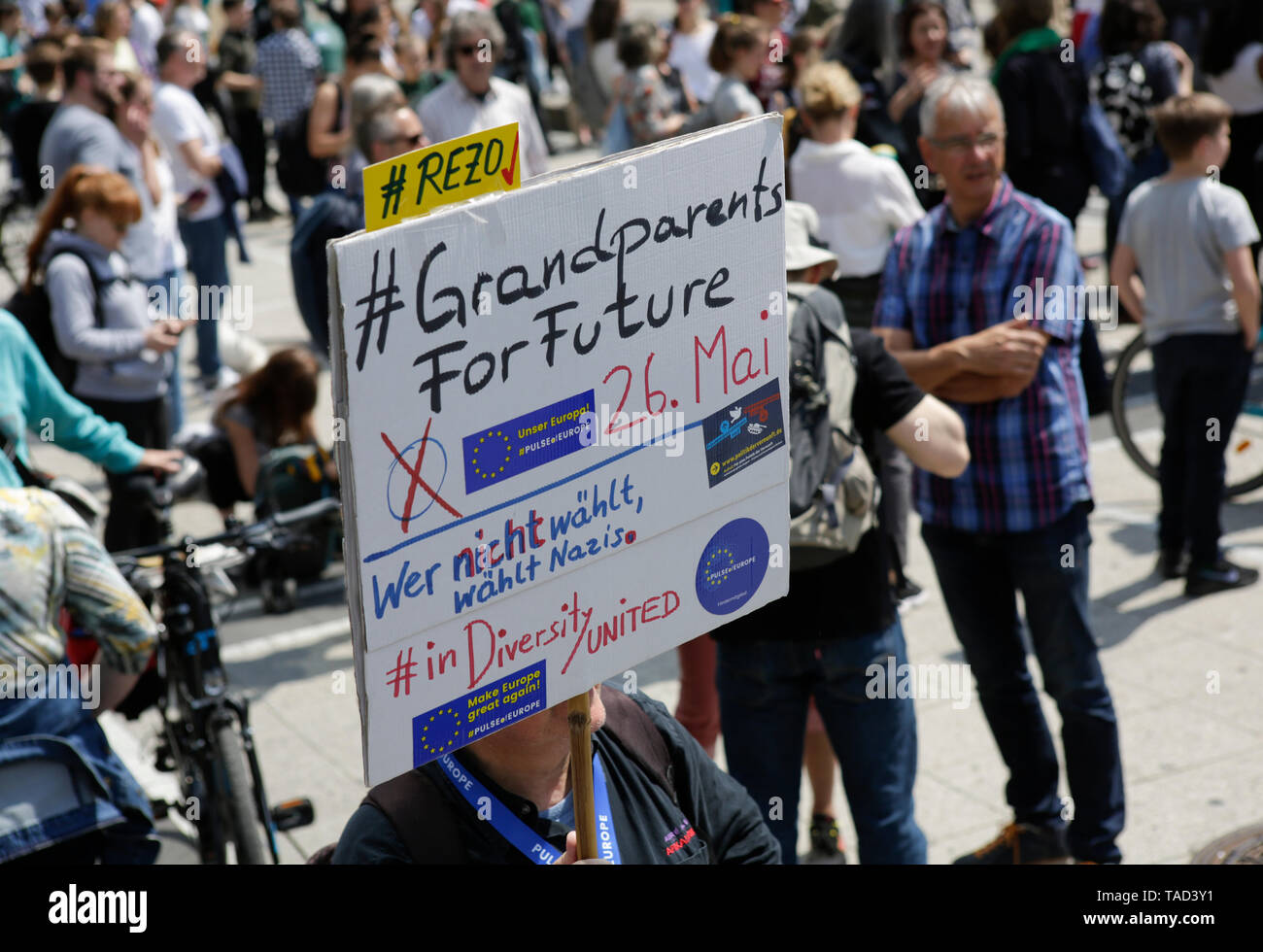 Frankfurt, Germany. 24th May 2019. A protester carries a sign that reads 'GrandparentsForFuture. He who won't vote votes Nazis'. Around 4,500 young people marched through Frankfurt to the European Central Bank, to protest against the climate change and for the introduction of measurements against it. The protest took place as part of an Europe wide climate strike, two days ahead of the 2019 European elections. - Stock Image