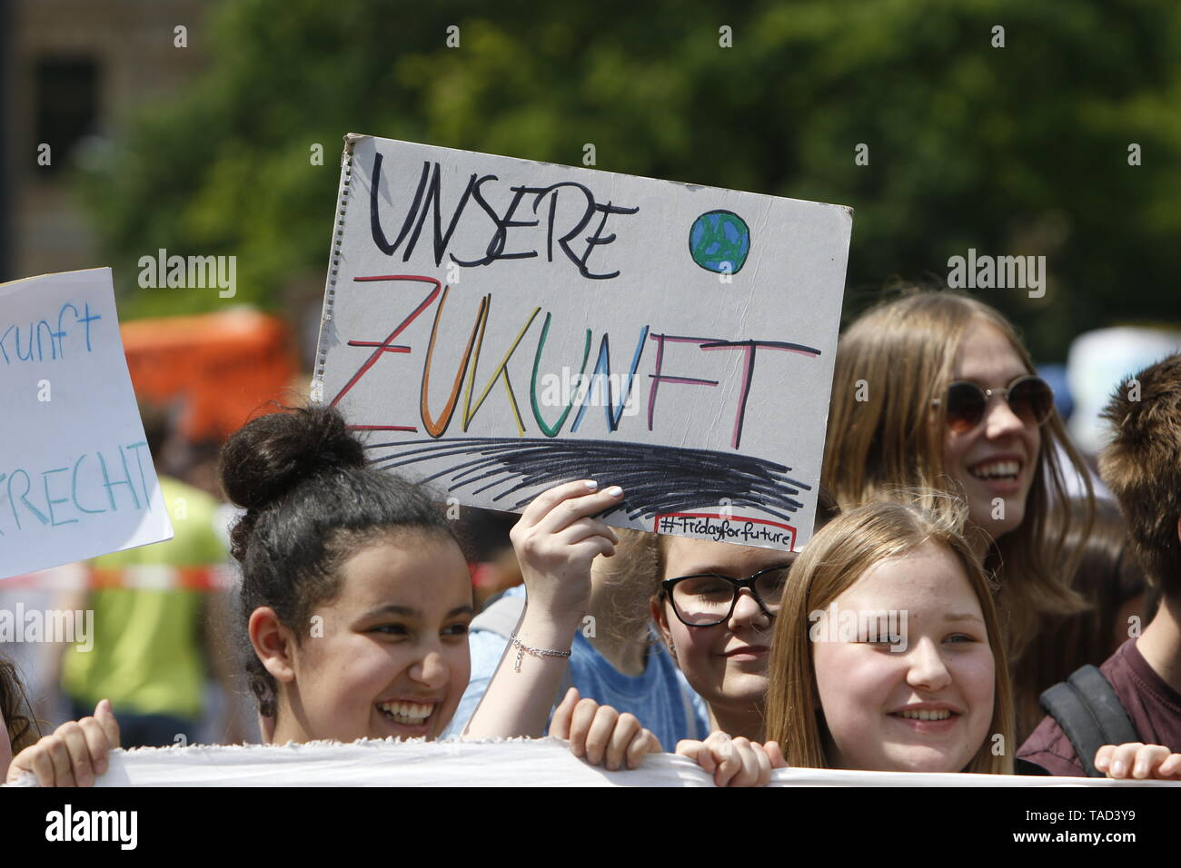 Frankfurt, Germany. 24th May 2019. A protester carries a sign that reads 'Our Future'. Around 4,500 young people marched through Frankfurt to the European Central Bank, to protest against the climate change and for the introduction of measurements against it. The protest took place as part of an Europe wide climate strike, two days ahead of the 2019 European elections. - Stock Image