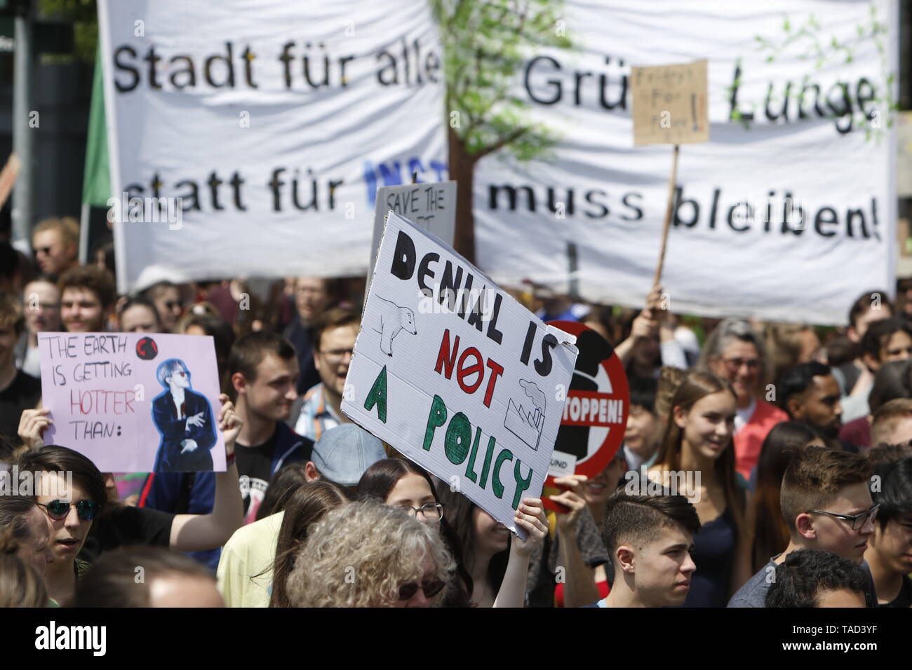 Frankfurt, Germany. 24th May 2019. A protester carries a sign that reads 'Denial is not a Policy' with a drawing of a polar bear. Around 4,500 young people marched through Frankfurt to the European Central Bank, to protest against the climate change and for the introduction of measurements against it. The protest took place as part of an Europe wide climate strike, two days ahead of the 2019 European elections. - Stock Image