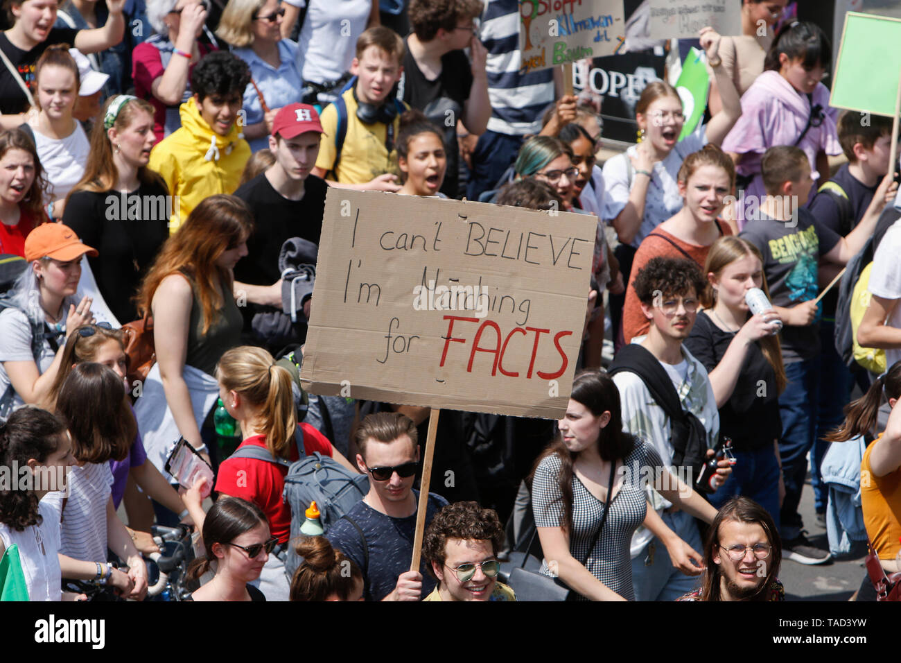 Frankfurt, Germany. 24th May 2019. A protester carries a sign that reads 'I can't believe I'm marching for facts'. Around 4,500 young people marched through Frankfurt to the European Central Bank, to protest against the climate change and for the introduction of measurements against it. The protest took place as part of an Europe wide climate strike, two days ahead of the 2019 European elections. - Stock Image