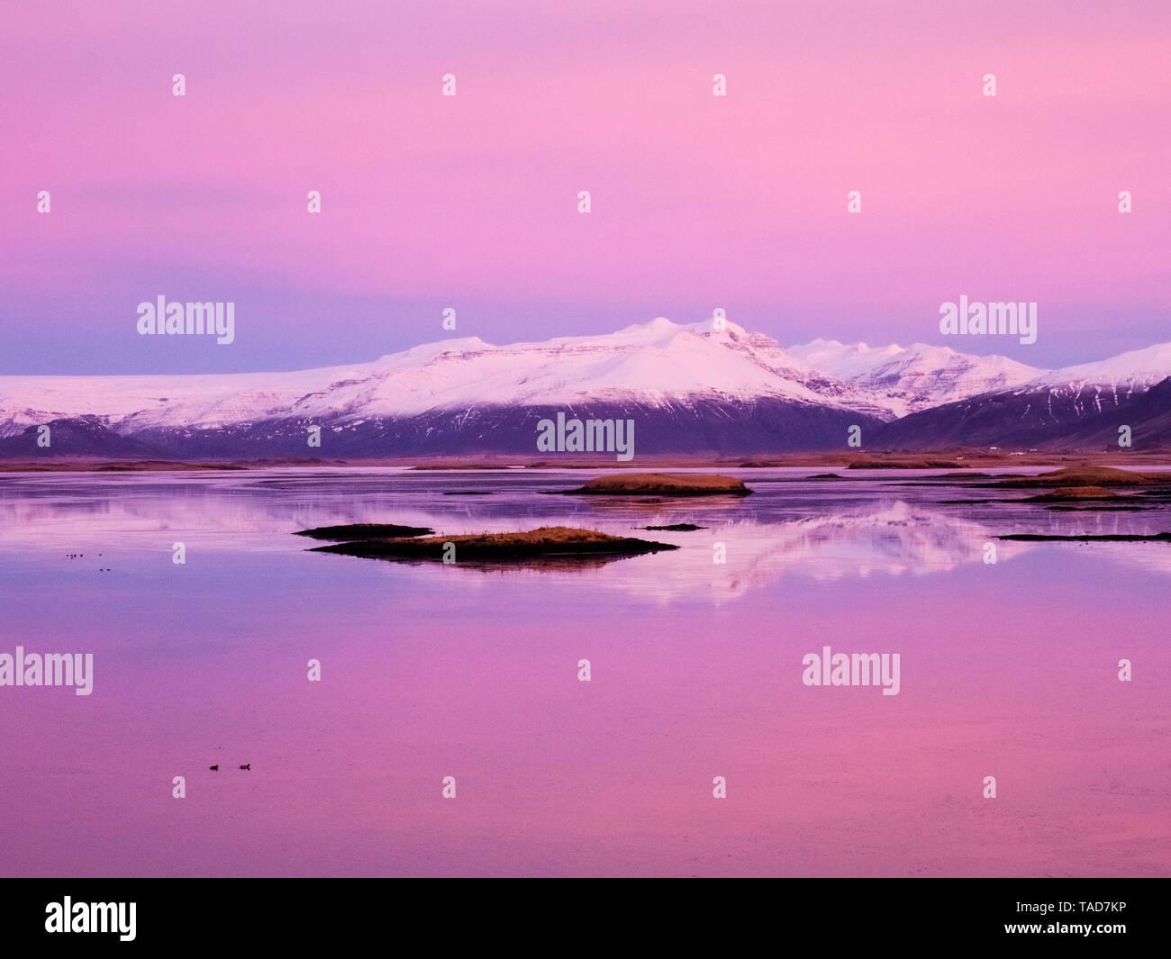 Iceland, Hoefn, sunrise over the Atlantic Ocean - Stock Image