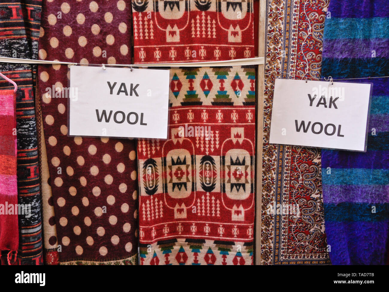 Yak wool products for sale in a narrow alley off Durbar Square, Bhaktapur, Kathmandu Valley, Nepal - Stock Image