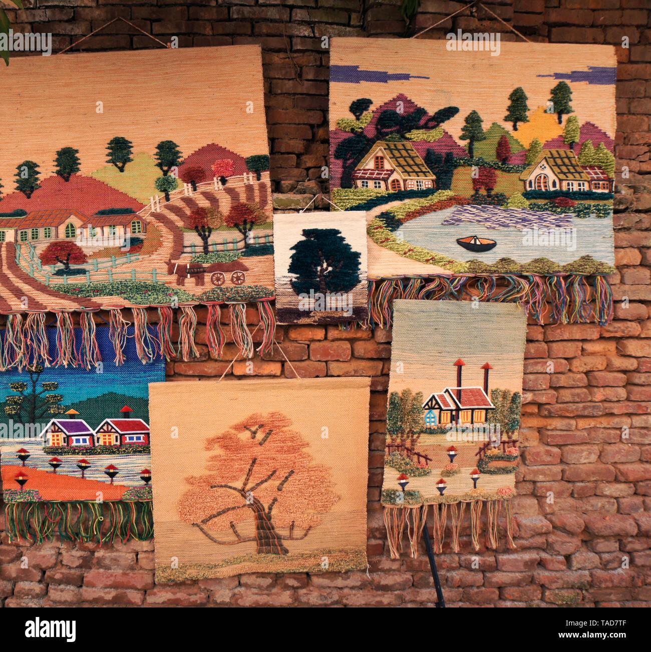 Woven and embroidered wall hangings for sale near Durbar Square, Bhaktapur, Kathmandu Valley, Nepal - Stock Image