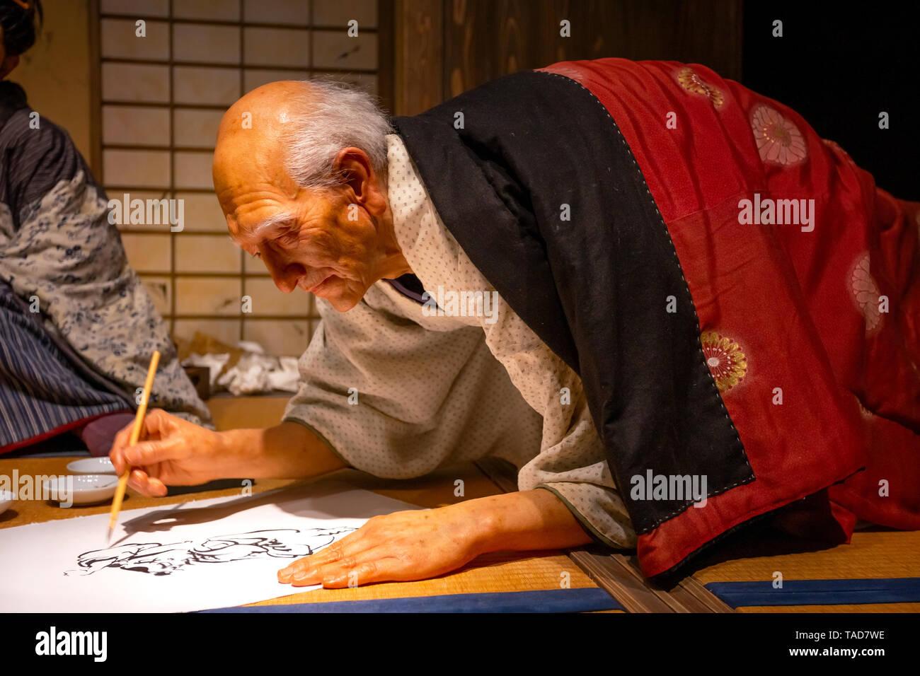 Tokyo, Japan - April 25, 2018: View of an animatronic figures of the Ukiyo-e artist (Japanese woodblock prints), Katsushika Hokusai and his daughter O - Stock Image