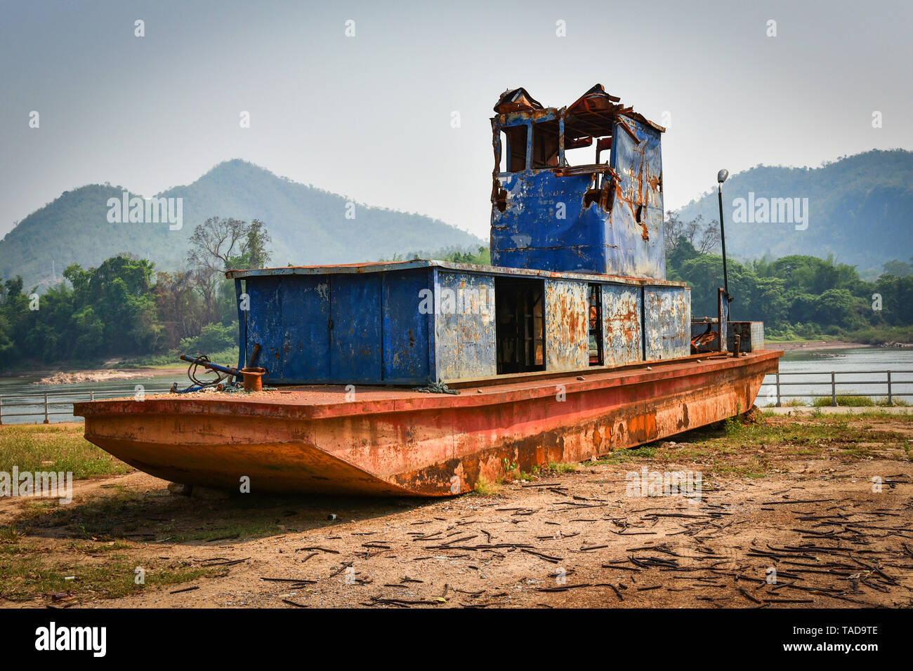 old boat on the riverside / ancient ship decay steel with rust metal iron - Stock Image
