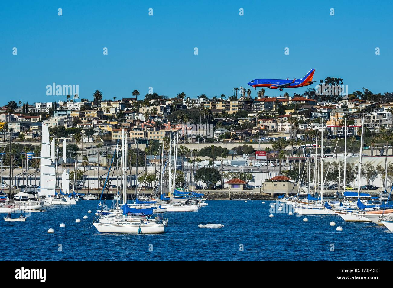 USA, California, San Diego, Airplane and sailing boats - Stock Image