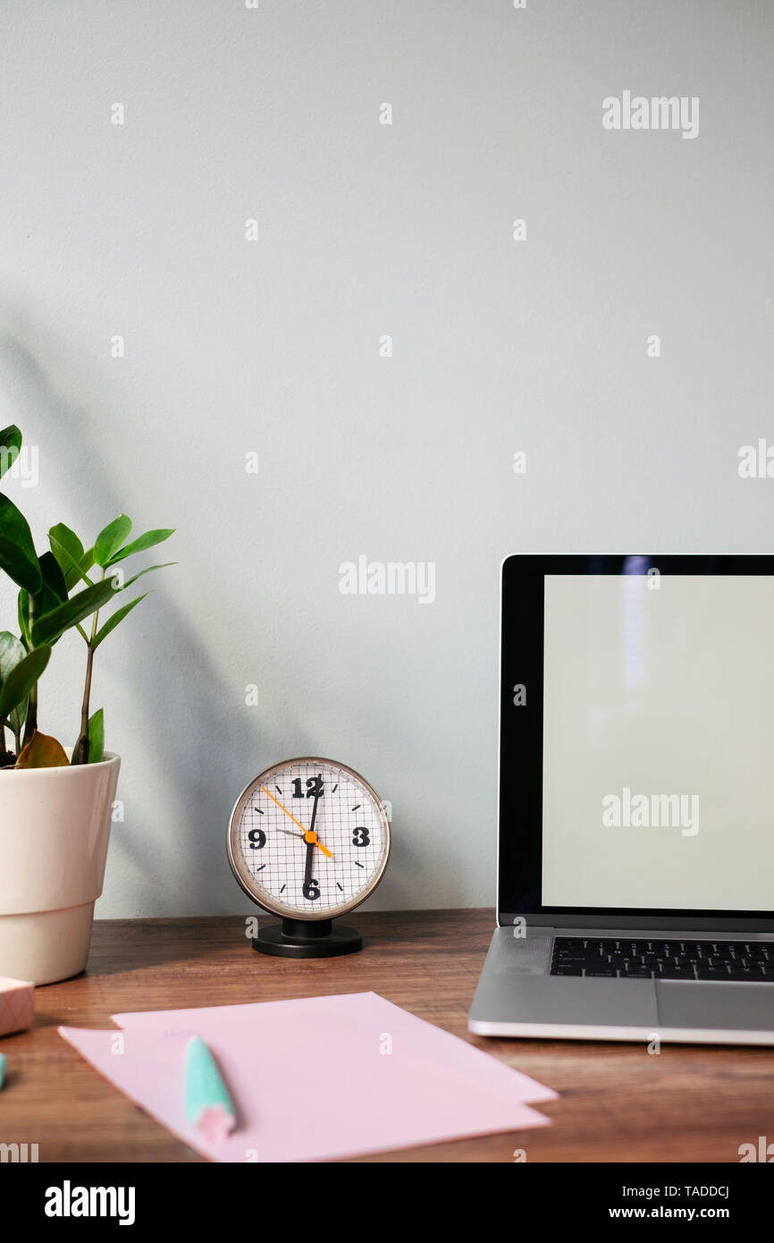 Desk with retro clock at home office - Stock Image