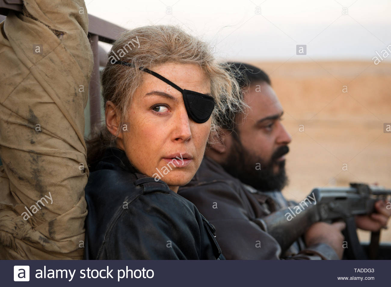 Undated film still handout from A Private War. Pictured: Rosamund Pike as Marie Colvin. See PA Feature SHOWBIZ Download Reviews. Picture credit should read: PA Photo/APW Film II, Limited/Altitude Film Distribution/Paul Conroy. All Rights Reserved. WARNING: This picture must only be used to accompany PA Feature SHOWBIZ Download Reviews. - Stock Image
