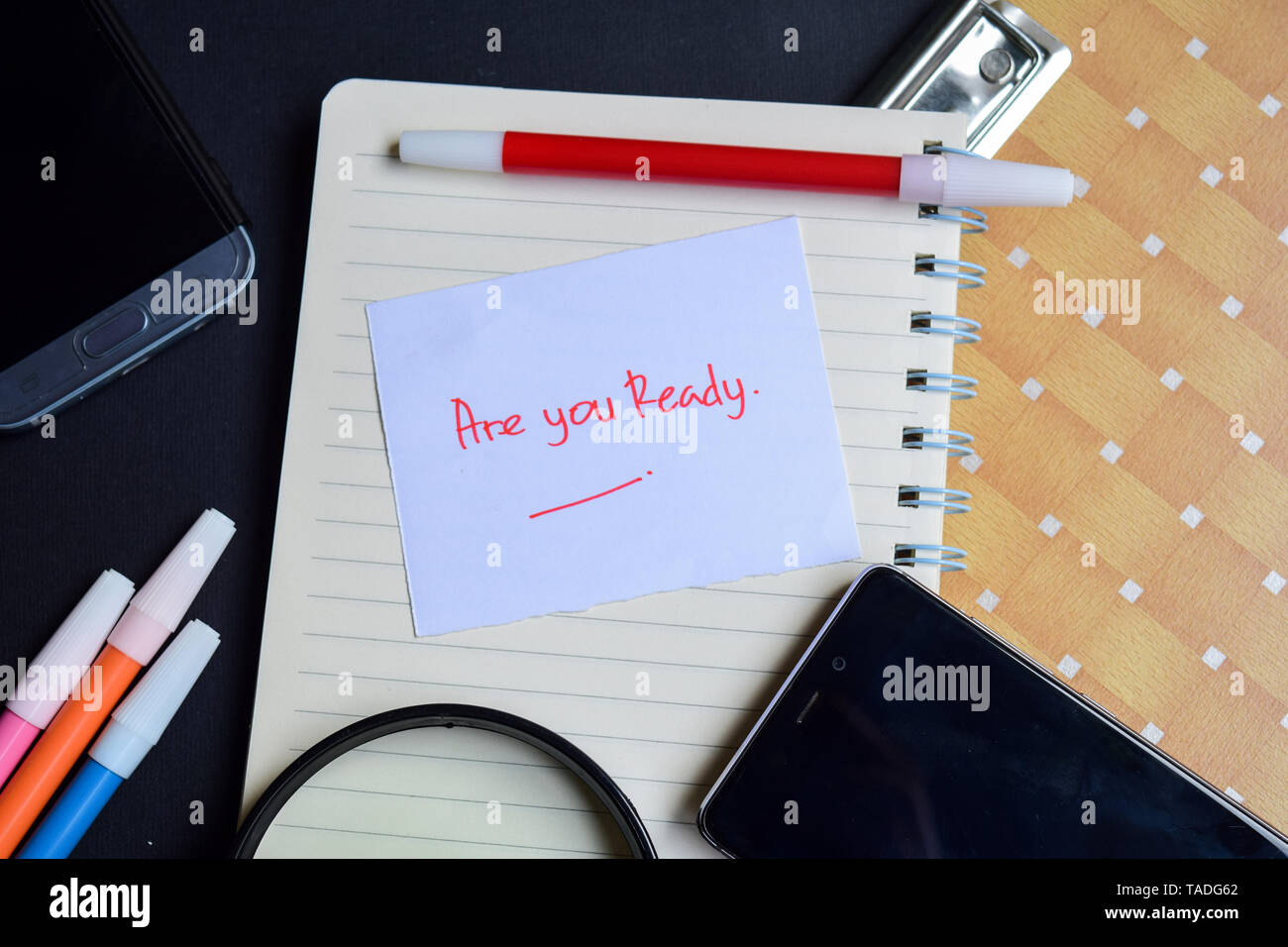 Are you Ready written on paper isolated on black table - Stock Image