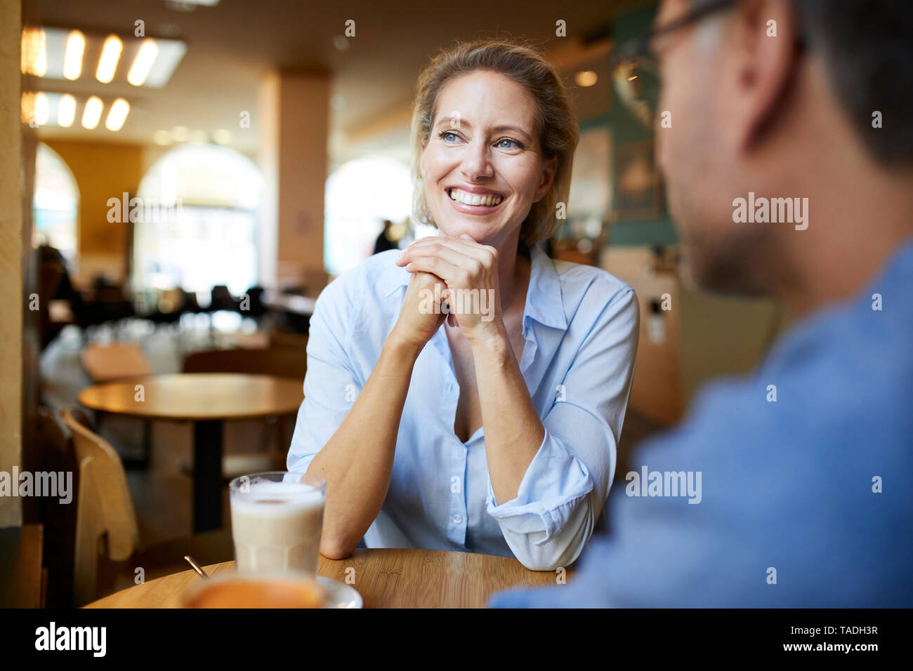 Portrait of happy woman with man in a cafe - Stock Image
