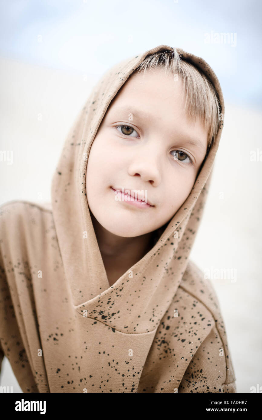 Portrait of confident boy wearing hoodie - Stock Image