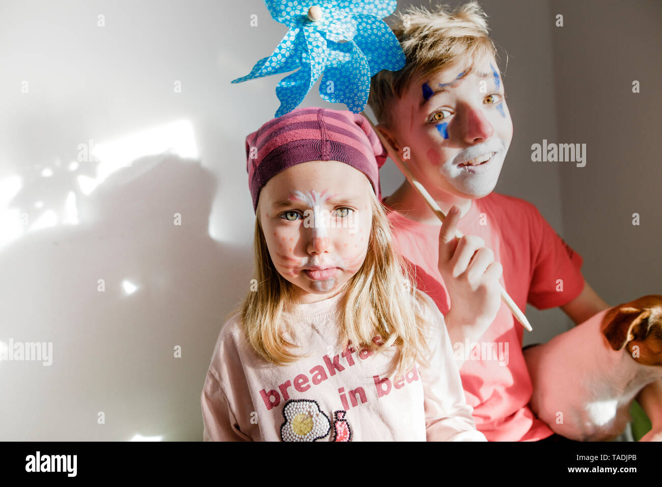 Portrait of boy and little sister made up for carnival - Stock Image