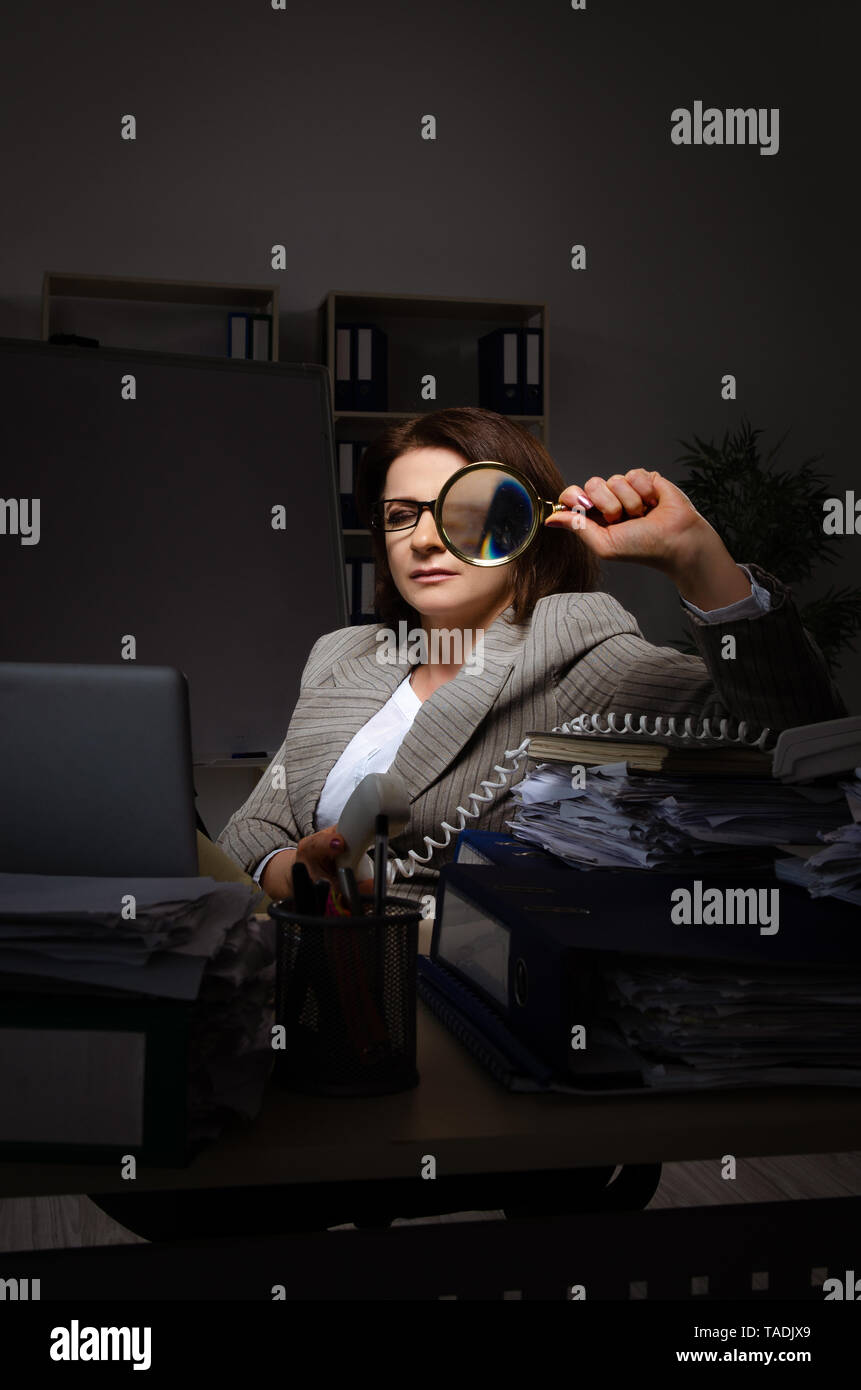 Female employee suffering from excessive work - Stock Image
