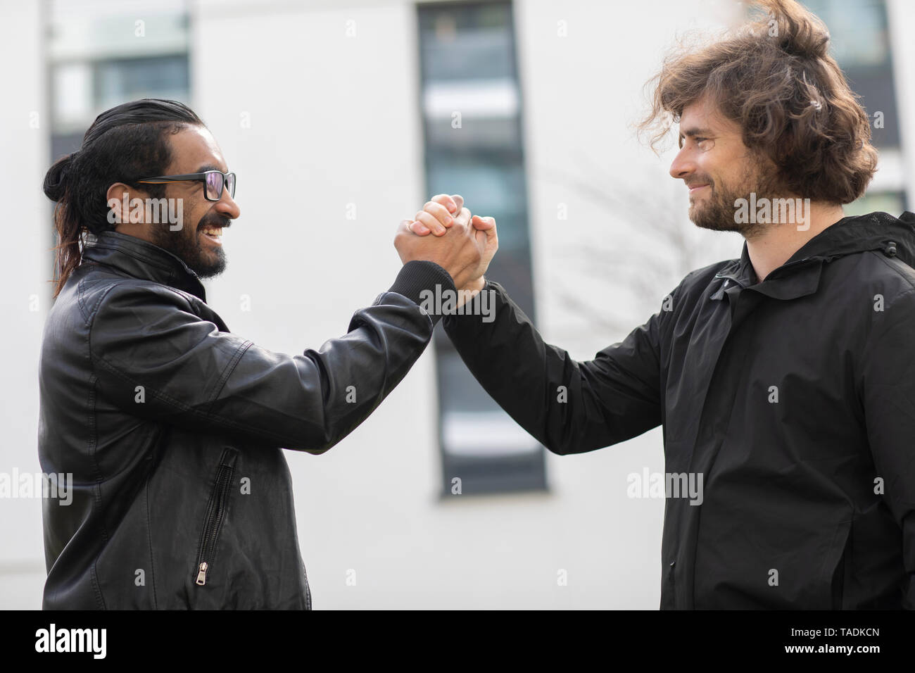 Two friends greeting each other Stock Photo