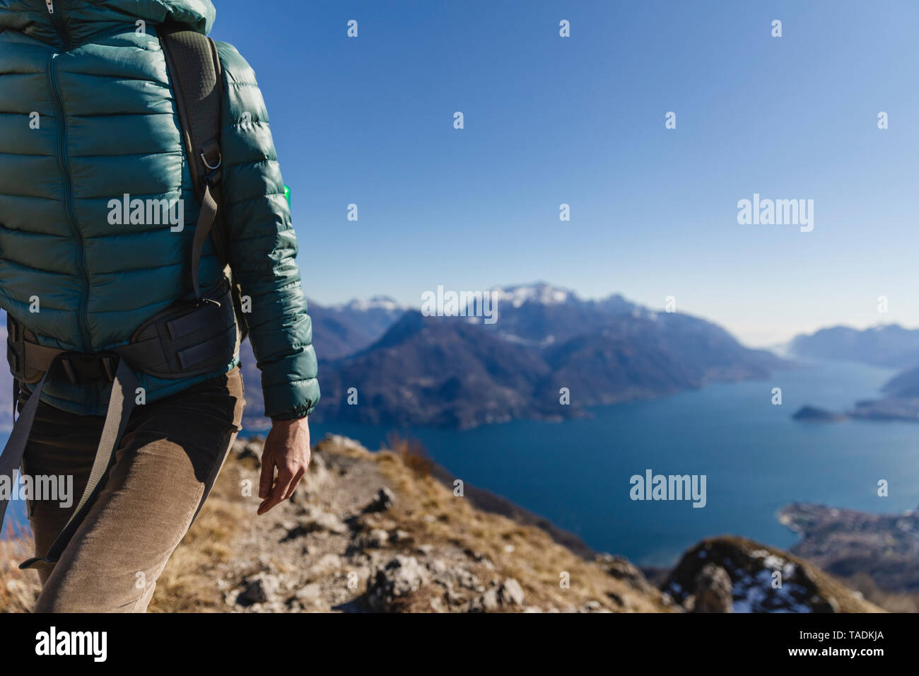 Italy, Como, Lecco, woman on a hiking trip in the mountains above Lake Como - Stock Image