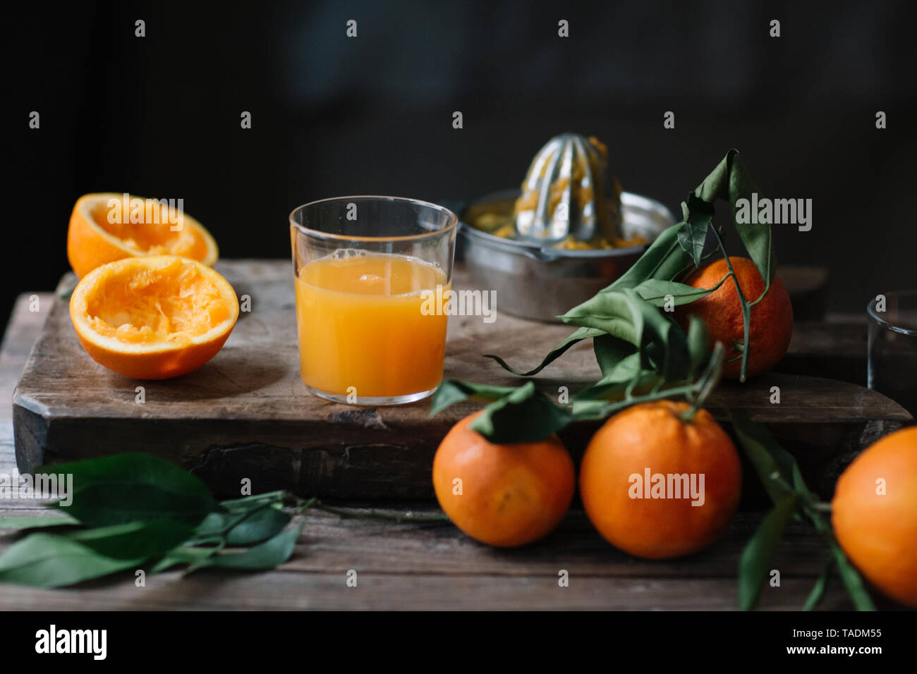 Glass of freshly squeezed orange juice - Stock Image
