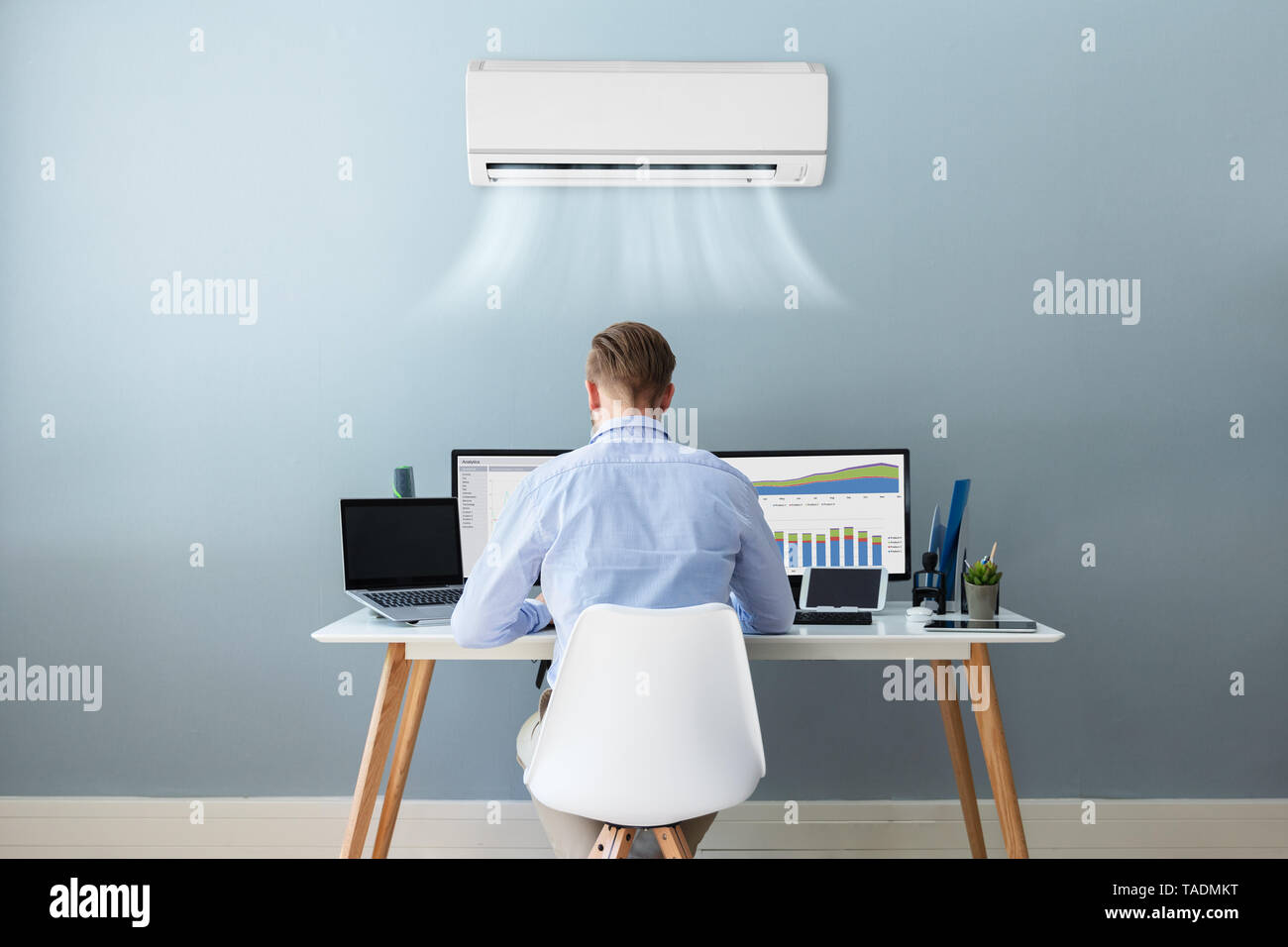 Young Businessman Working In Office With Air Conditioning - Stock Image