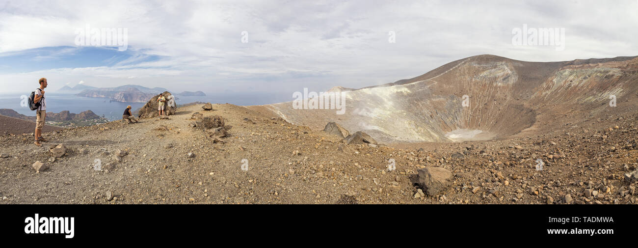 Aeolian Islands, Vulcano, Panoramic view from volcano, Gran Cratere, hikers at volcanic crater Stock Photo