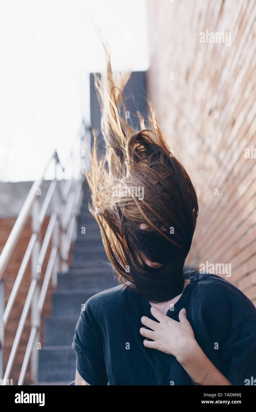 Spain, hair covering face of teenage girl Stock Photo
