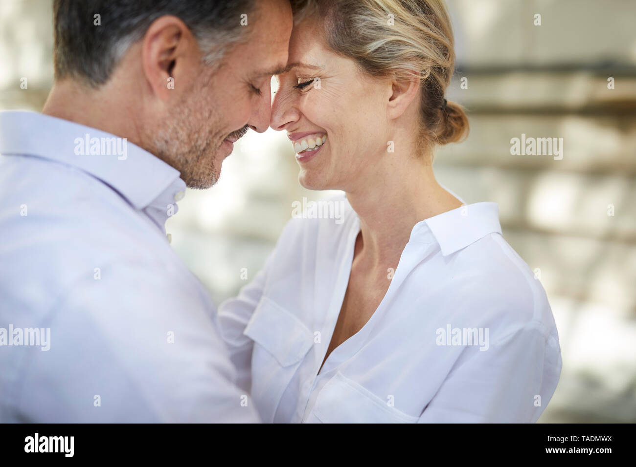 Close-up of happy affectionate couple outdoors - Stock Image