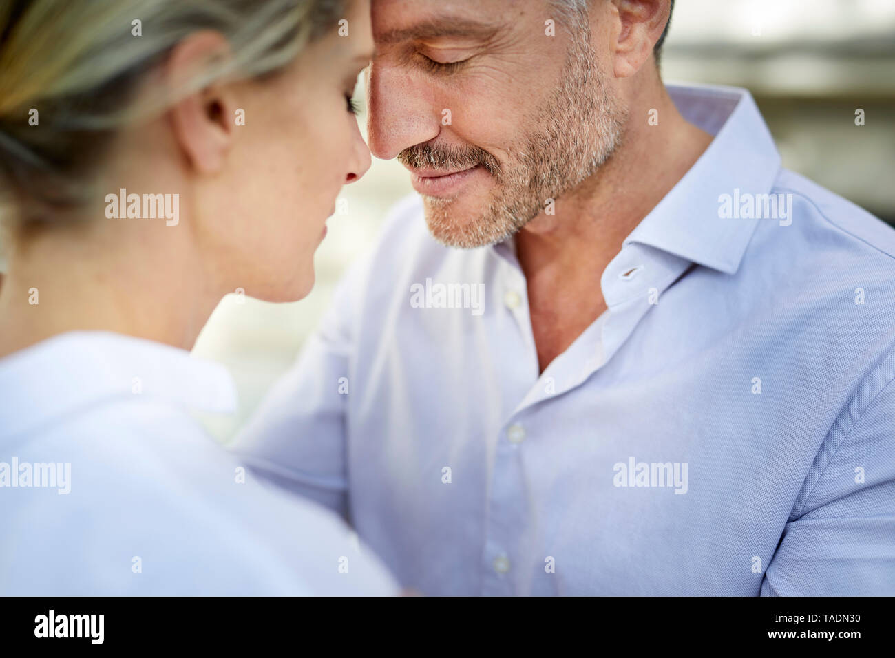 Close-up of affectionate couple outdoors - Stock Image