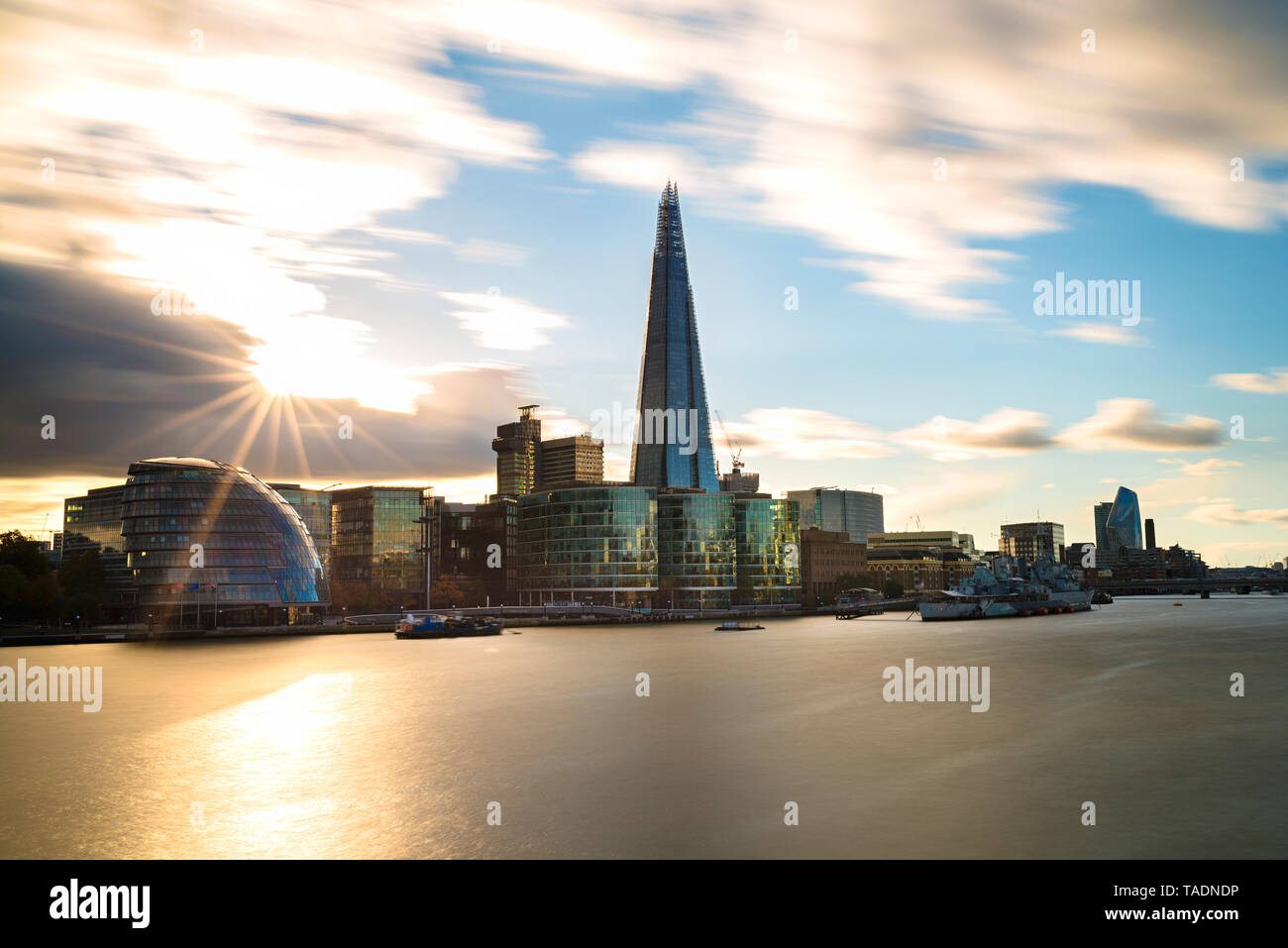UK, London, River Thames, skyline with City Hall and The Shard at sunset Stock Photo