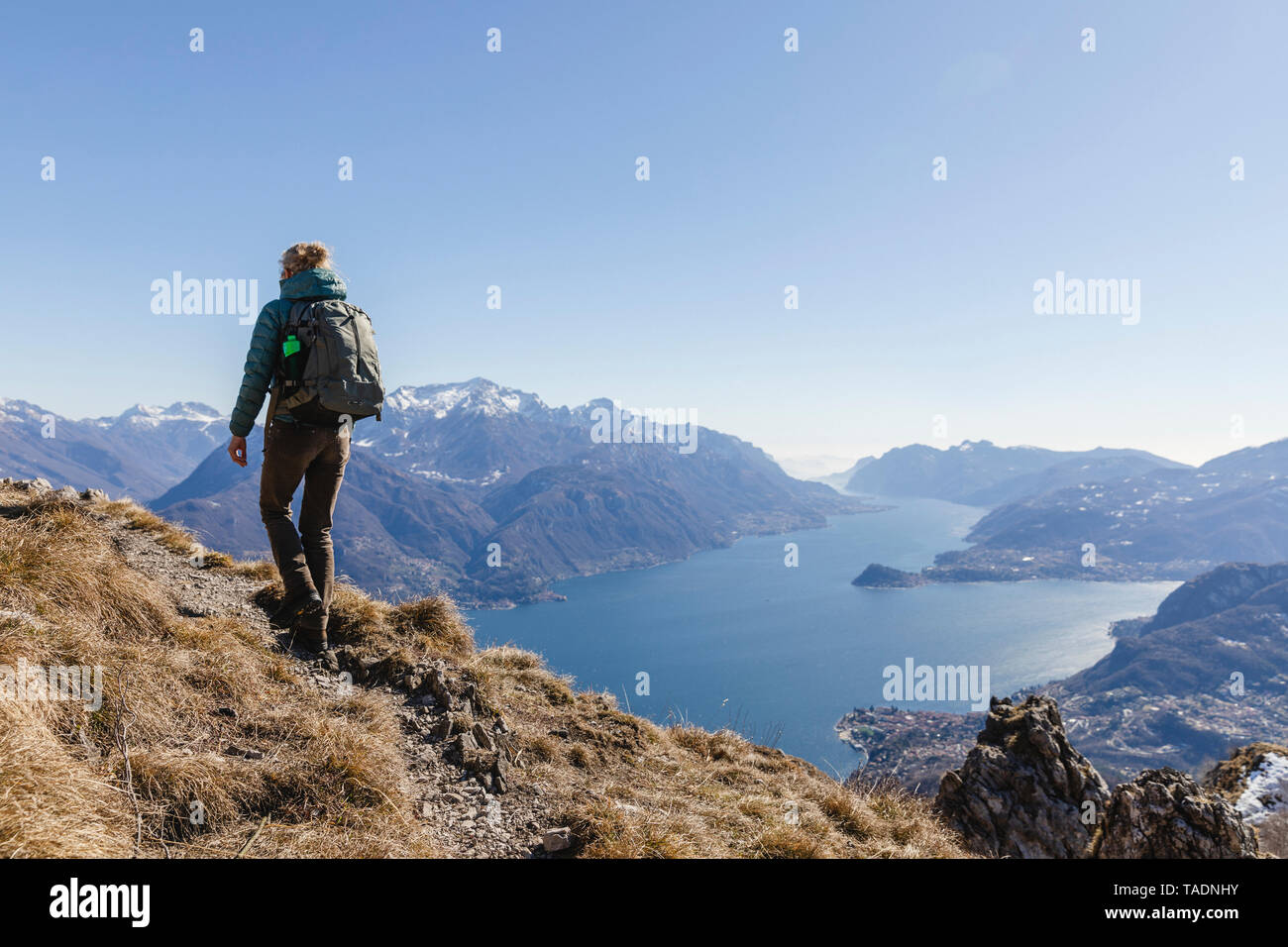 Italy, Como, woman on a hiking trip in the mountains above Lake Como - Stock Image