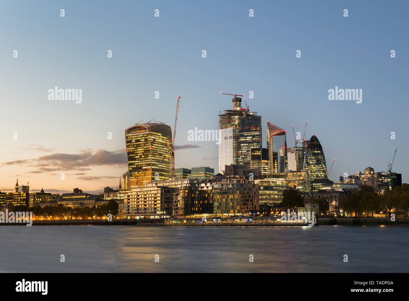 UK, London, City of London, River Thames, skyline with modern office buildings at sunset Stock Photo