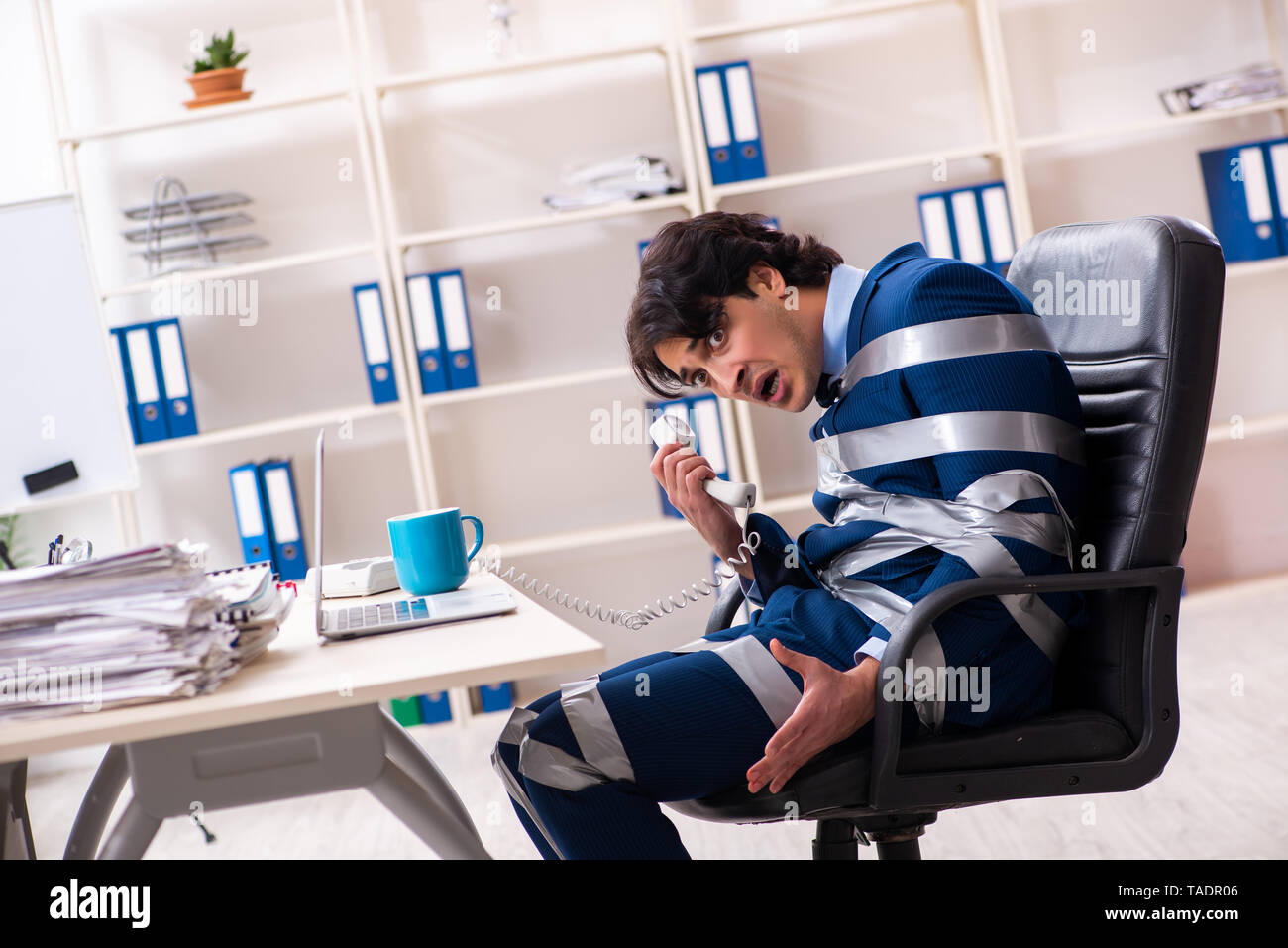 Young tied male employee in the office - Stock Image