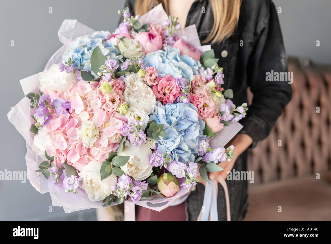 Large Beautiful bouquet of mixed flowers in woman hand. Floral shop concept . Beautiful fresh cut bouquet. Flowers delivery Stock Photo