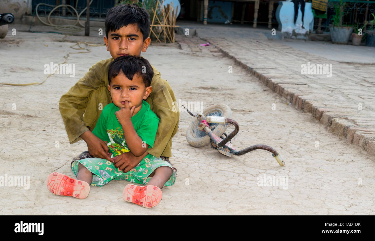 rahim yar khan,punjab,pakistan-May 23,2019:two children effected by malnutrition,no toys to play. - Stock Image