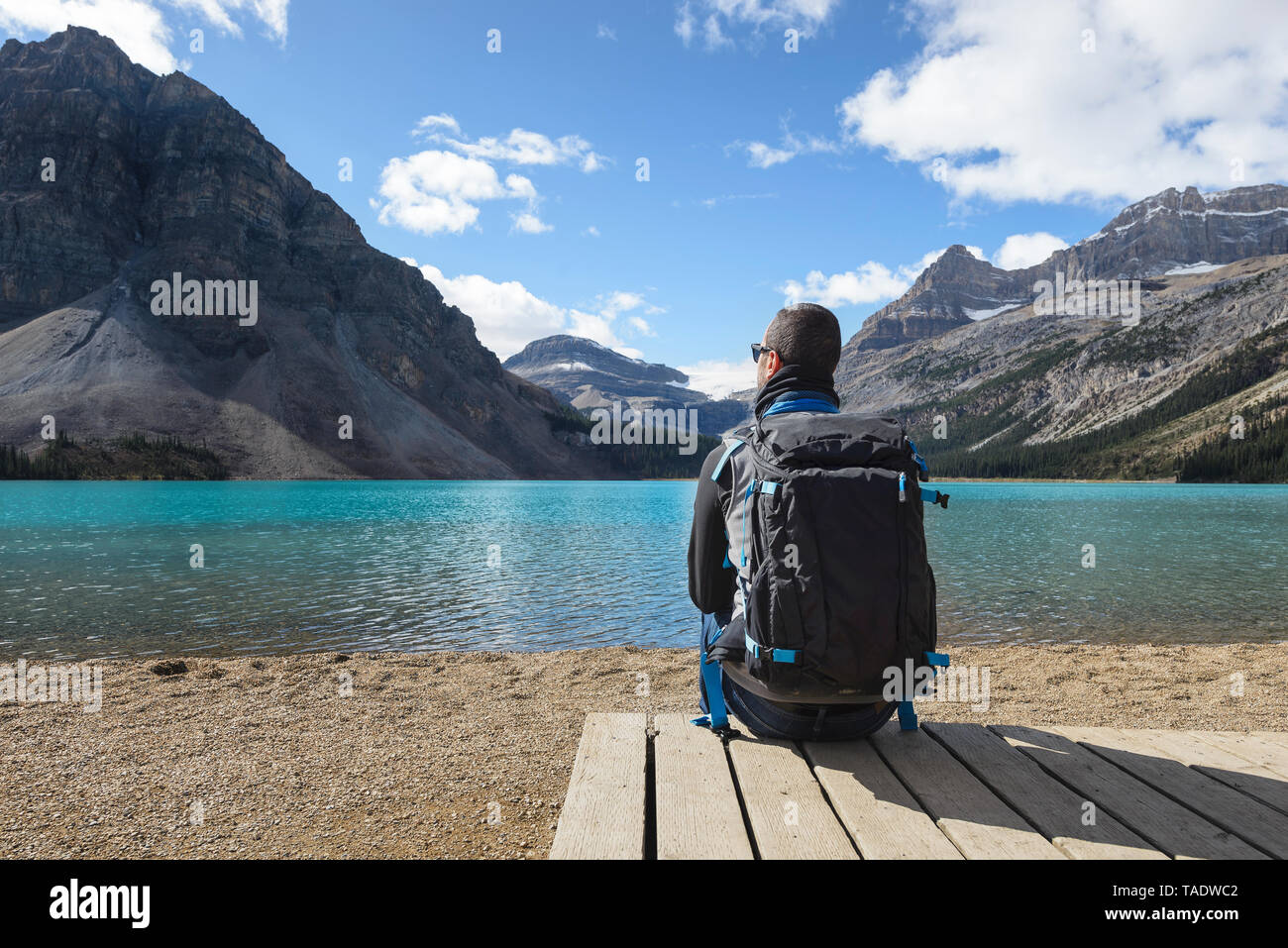 Canada, Jasper and Banff National Park, Icefields Parkway, man at lakeside - Stock Image