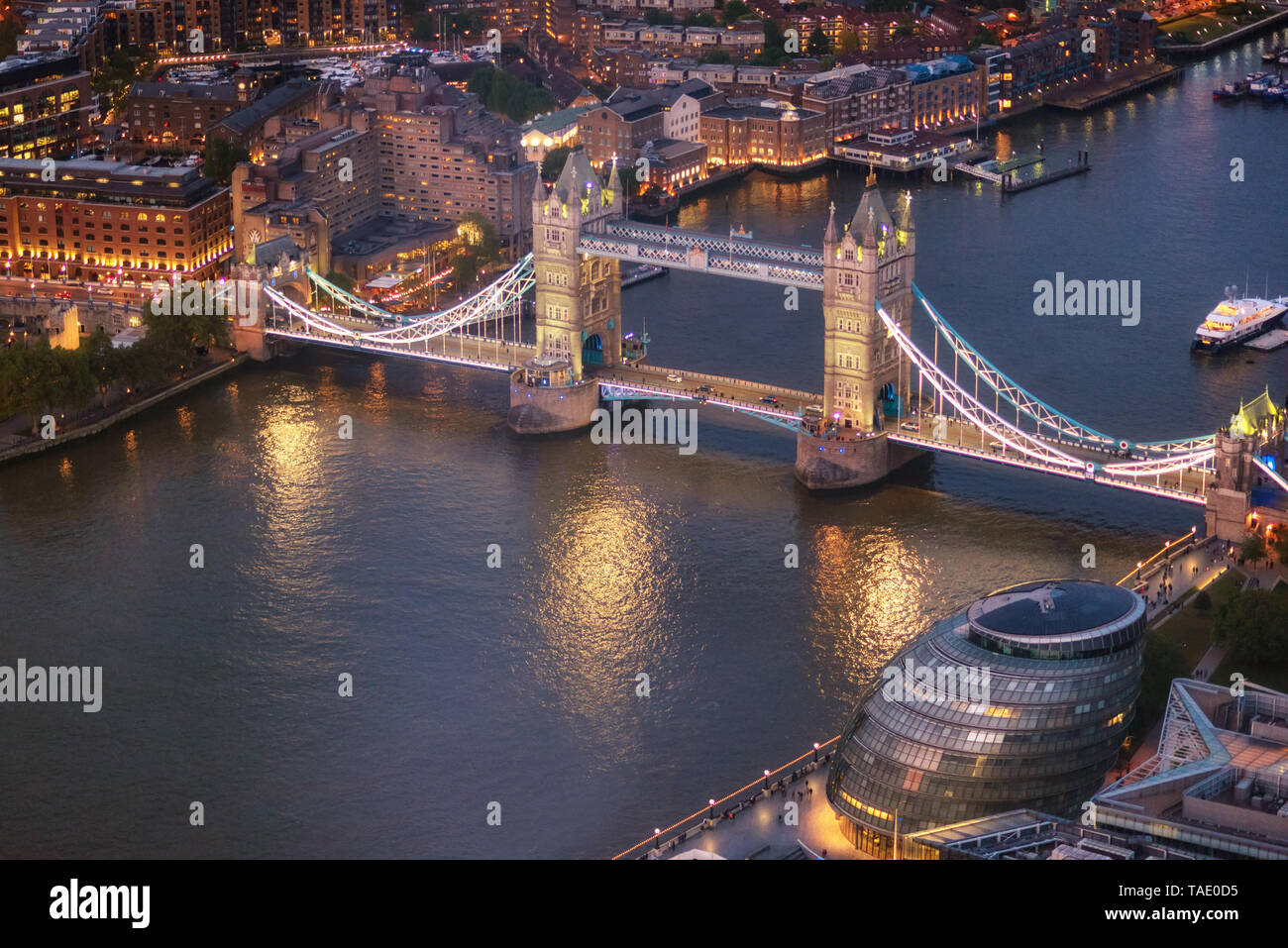 Tower Bridge and River Thames aerial view at magic hour, London, United Kingdom . Stock Photo