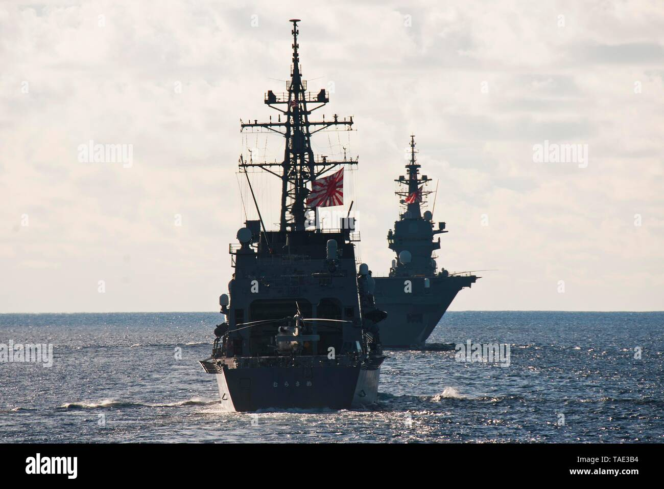 190521-N-VA840-0046 INDIAN OCEAN (May 21, 2019) The Japan Maritime Self Defense Force Izumo-class helicopter destroyer JS Izumo (DDH 183), and the Murasame-class destroyer JS Murasame (DD 101), and the Royal Australian Navy's HMAS Collins (SSG 73) participate in a multi-nation group sail in the Indian Ocean. The Arleigh Burke-class guided-missile destroyer USS William P. Lawrence (DDG 110), the Henry J. Kaiser-class fleet replenishment oiler USNS Pecos (T-AO 197) sailed in formation, alongside ships and aircraft from the French, Japanese, and Australian navies. William P. Lawrence is deployed  - Stock Image