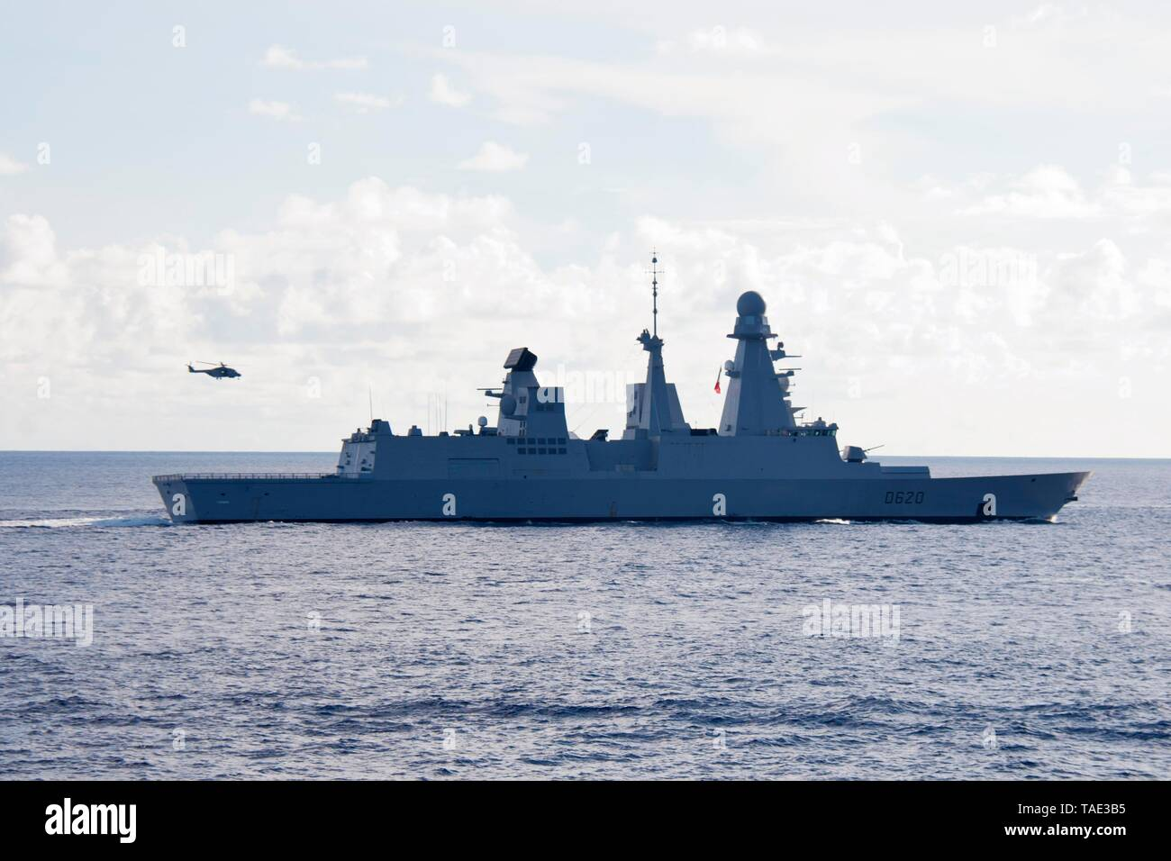 190521-N-VA840-0040 INDIAN OCEAN (May 21, 2019) The French frigate FS Forbin (D620) sails alongside the Arleigh Burke-class guided-missile destroyer USS William P. Lawrence (DDG 110) during a multi-nation group sail in the Indian Ocean. William P. Lawrence is deployed to the U.S. 7th Fleet area of operations in support of security and stability in the Indo-Pacific region. (U.S. Navy photo by Mass Communication Specialist 1st Class Leonard Adams) - Stock Image